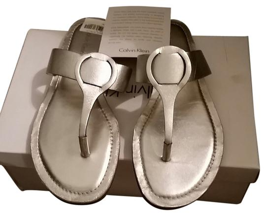 Preload https://item5.tradesy.com/images/calvin-klein-metallic-silver-sandals-size-us-65-5496859-0-0.jpg?width=440&height=440