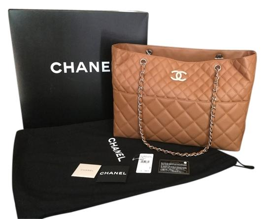 Preload https://item3.tradesy.com/images/chanel-xl-gst-in-light-brown-quilt-and-silver-hardware-camel-leather-weekendtravel-bag-5503957-0-0.jpg?width=440&height=440