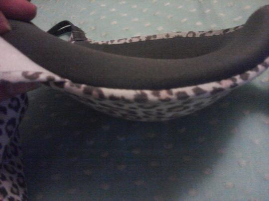Maidenform Maidenform Bra--animal print trimed in dark gray--top of bra cup is lightly padded, the bottom half of the cup is heavily padded--