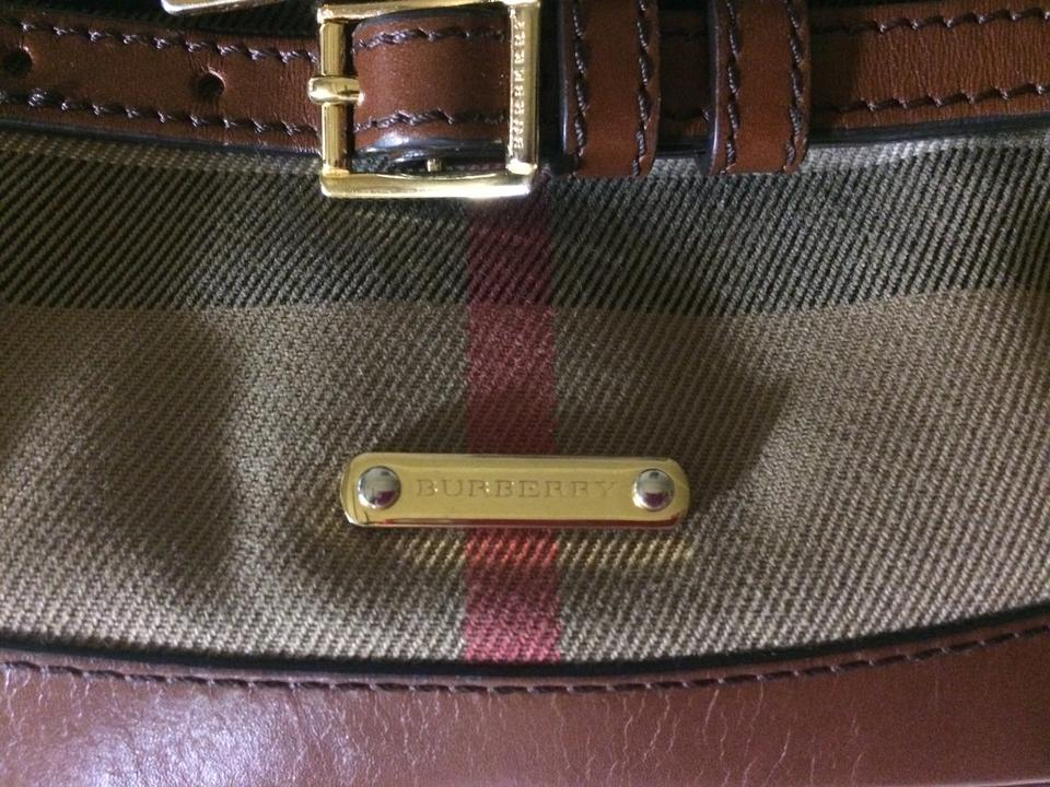 abd9f4494918 Burberry Bridle Peyton Wristlet Dark Tan House Check and Leather ...