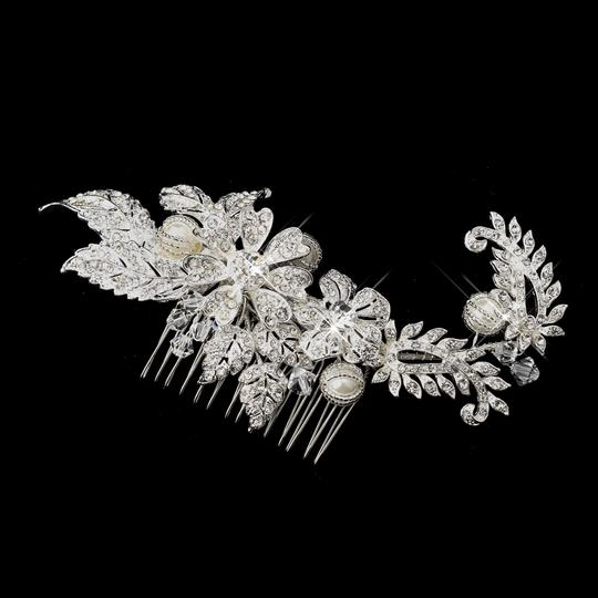 Preload https://item5.tradesy.com/images/dazzling-swarovski-crystal-rhinestone-ivory-pearl-comb-hair-accessory-5521639-0-0.jpg?width=440&height=440