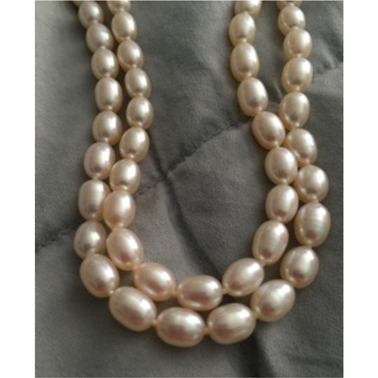 Chinese Fresh Water Pearls oval shape Chinese fresh water pearls, white over tone color