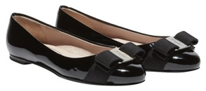 Salvatore Ferragamo Blacks with silver pendant Flats