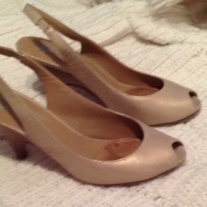 Donald J. Pliner Gold Pumps