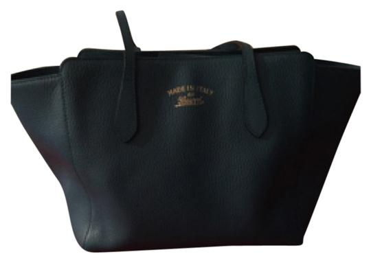 Preload https://item4.tradesy.com/images/gucci-swing-small-leather-tote-satchel-5537488-0-0.jpg?width=440&height=440