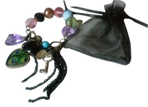 peacock heart and multi charm bracelet w/ pouch
