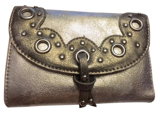 Preload https://item2.tradesy.com/images/silver-walletclutch-with-grommets-new-wo-tag-wallet-5539201-0-0.jpg?width=440&height=440
