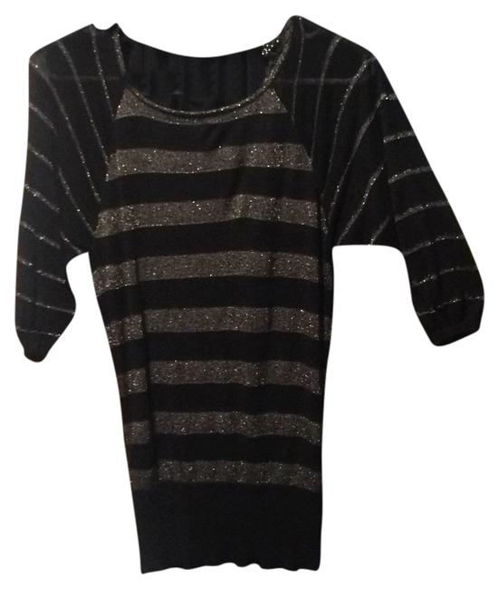 Preload https://item4.tradesy.com/images/guess-black-and-gold-blouse-size-12-l-5546173-0-0.jpg?width=400&height=650