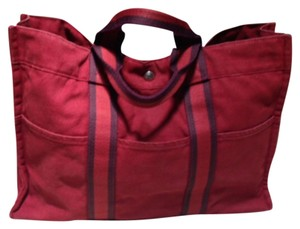Hermès Tote in Deep Red With Black Striped Trim