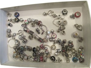 Lot of 2 charm bracelets and lots beads 100 silver tone