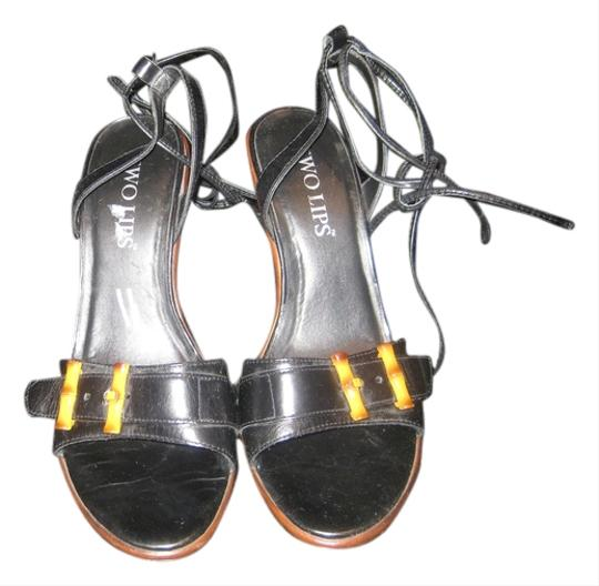 Preload https://item2.tradesy.com/images/two-lips-black-leather-wbamboo-trim-heels-ankle-tie-sandals-size-us-8-regular-m-b-5560426-0-0.jpg?width=440&height=440