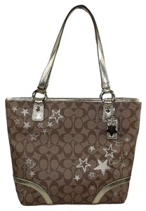 Coach Tote in Signature khaki jacquard with brown C print pattern, gold stars