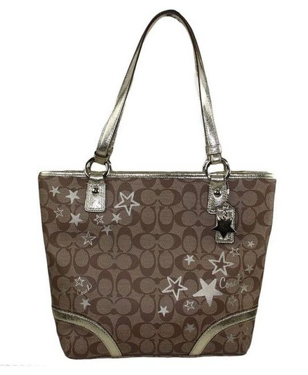 Coach Canvas Tote in Signature khaki jacquard with brown C print pattern, gold stars