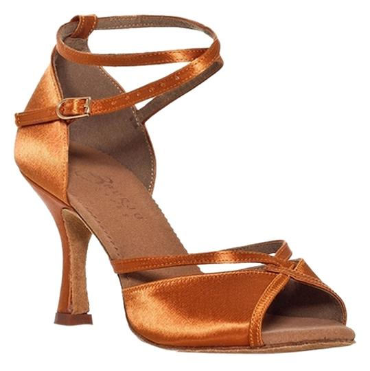 Preload https://item4.tradesy.com/images/dark-tan-linked-flared-heel-formal-shoes-size-us-75-5573998-0-0.jpg?width=440&height=440