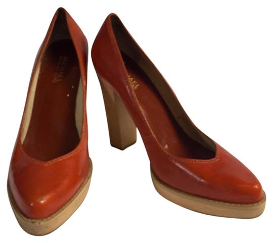 Preload https://item2.tradesy.com/images/michael-michael-kors-by-burnt-orange-wood-platforms-size-us-9-regular-m-b-5577616-0-0.jpg?width=440&height=440