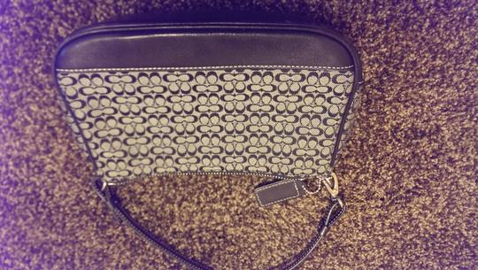 Coach Black and white Clutch