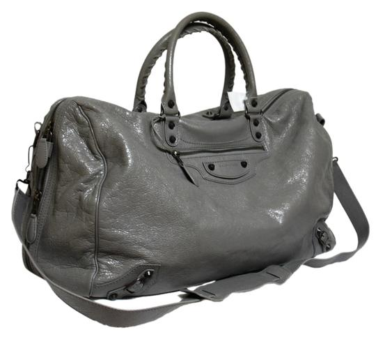 Preload https://item1.tradesy.com/images/balenciaga-new-hr-duffle-pyrite-arena-gris-leather-weekendtravel-bag-5580640-0-0.jpg?width=440&height=440
