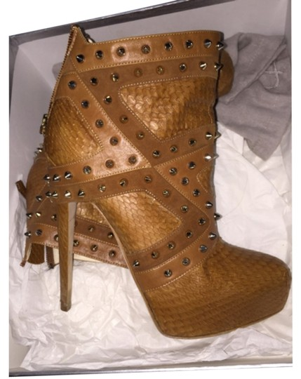 Preload https://item5.tradesy.com/images/brian-atwood-neutral-inez-bootsbooties-size-us-8-regular-m-b-5608414-0-0.jpg?width=440&height=440