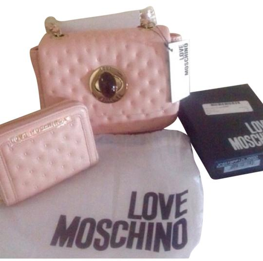 Preload https://item4.tradesy.com/images/moschino-baby-pink-leather-cross-body-bag-5614048-0-0.jpg?width=440&height=440
