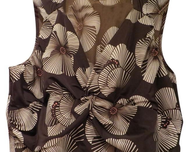 Preload https://item3.tradesy.com/images/maurices-flowy-sleeveless-v-neck-top-dark-brown-and-floral-print-561652-0-0.jpg?width=400&height=650