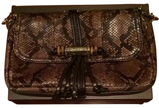 Preload https://item4.tradesy.com/images/gucci-l-brown-snake-skin-clutch-5618098-0-0.jpg?width=440&height=440