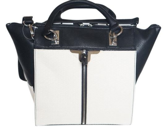 Preload https://item1.tradesy.com/images/danielle-nicole-polyurethane-tote-bag-black-and-white-5627185-0-0.jpg?width=440&height=440