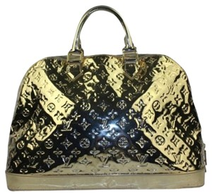 Louis Vuitton Satchel in Gold