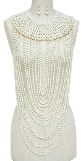 Preload https://item3.tradesy.com/images/cream-gold-multi-strands-of-pearl-and-earring-necklace-5632792-0-7.jpg?width=440&height=440