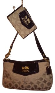 Coach Coin Wristlet in gold