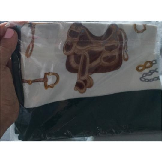 Silk scarf wrapped with clear bag, sealed