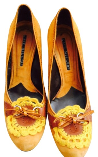 Preload https://item3.tradesy.com/images/yellow-pumps-size-us-95-regular-m-b-5689402-0-0.jpg?width=440&height=440