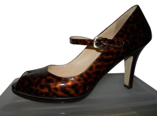 Preload https://item1.tradesy.com/images/cole-haan-black-and-brown-patent-leather-carma-open-toe-tortois-pumps-size-us-85-regular-m-b-5700220-0-0.jpg?width=440&height=440