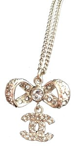 Chanel Chanel Gold Bow Knot Swarovski Crystal CC LOGO DANGLE PENDANT NECKLACE