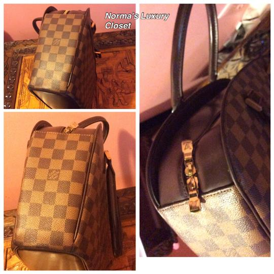 Louis Vuitton Dust Satchel in Brown