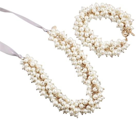 Preload https://item5.tradesy.com/images/other-faux-pearl-necklace-and-bracelet-set-5740714-0-1.jpg?width=440&height=440