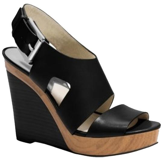 Preload https://item4.tradesy.com/images/michael-kors-black-wedges-size-us-8-5745718-0-2.jpg?width=440&height=440