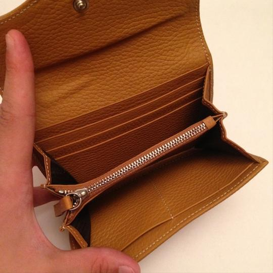 Tod's Tod's Tan Pebbled Leather Wallet