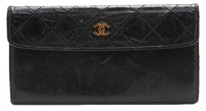 Chanel CHANEL Black Quilted Gold CC Logo Small Pouch