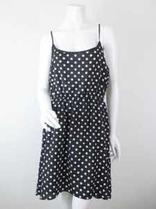 Olive + Oak short dress Black, White The Buckle Polka Dot Hi Low Hem Sun on Tradesy