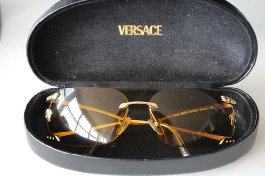 Versace Unique Versace Hazel sunglasses with leather case.