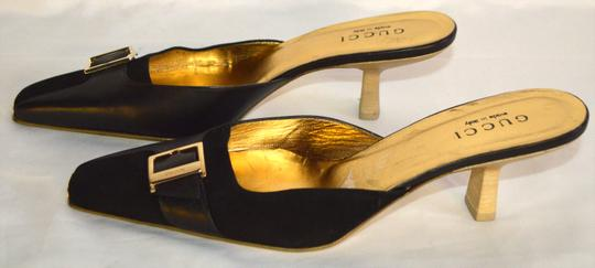 Gucci black / gold Pumps