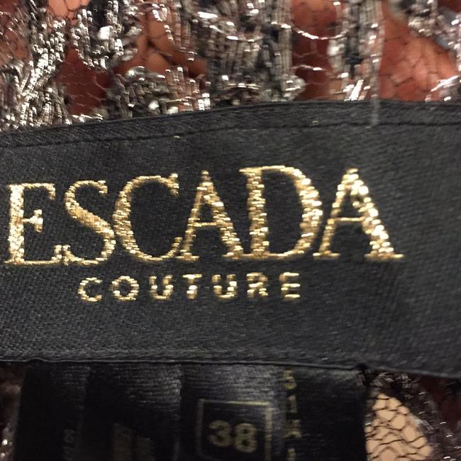 ESCADA is top and dress from pamela. Dennis couture Dress