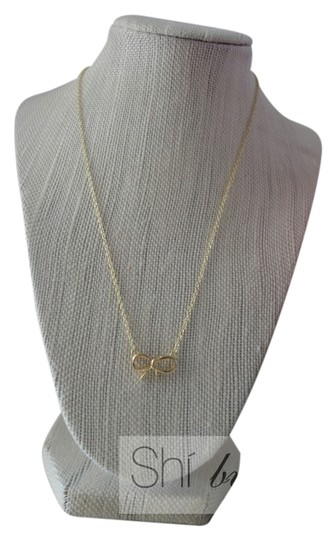 Preload https://item3.tradesy.com/images/gold-bow-necklace-5846092-0-0.jpg?width=440&height=440