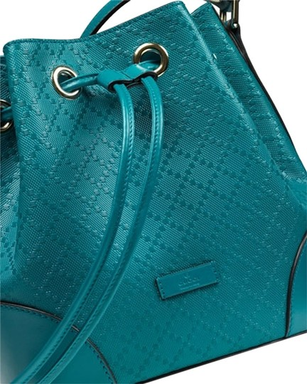 Preload https://item4.tradesy.com/images/gucci-leather-bucket-shoulder-bag-turquoise-blue-5865118-0-0.jpg?width=440&height=440