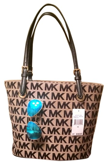 Preload https://img-static.tradesy.com/item/5868946/michael-kors-jet-set-black-and-tan-fabric-with-leather-trim-tote-0-2-540-540.jpg