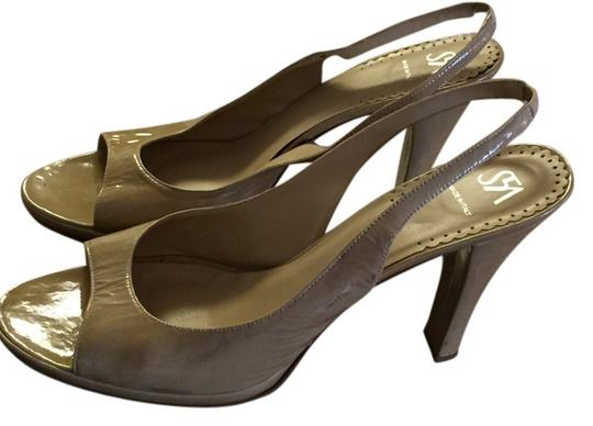 Preload https://item2.tradesy.com/images/saks-5th-ave-tan-leather-pumps-5882506-0-0.jpg?width=440&height=440