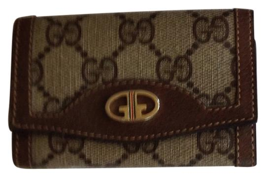 Preload https://item2.tradesy.com/images/gucci-brown-vintage-key-case-6-loops-gg-rare-5882611-0-0.jpg?width=440&height=440