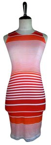 Lisa Nieves short dress Orange White Short Sleeveless Fitted Stretch on Tradesy