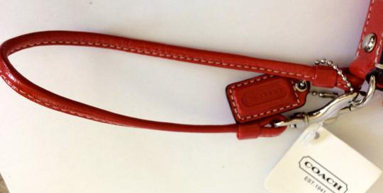 Coach Monogram Wristlet in Red/Bright Orange