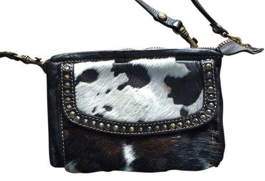 Preload https://item5.tradesy.com/images/campomaggi-black-leather-and-cowhide-cross-body-bag-5929219-0-4.jpg?width=440&height=440
